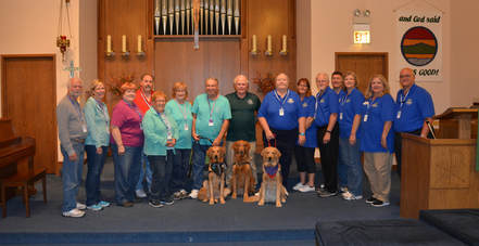 golden retrievers being welcomed into church family