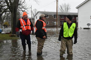 disaster response volunteers cleaning up following floods