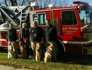 comfort dogs visiting funeral of a firefighter